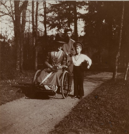 Nicholas II, Alexandra Fedorovna and cesarevitch Alexei on a walk in the park. 1910's.
