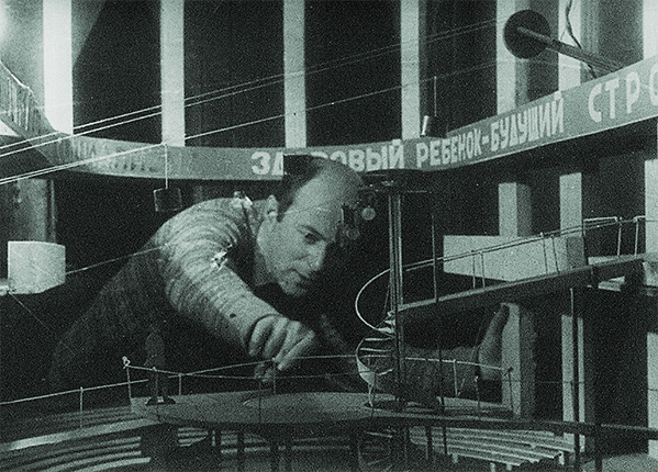 El Lissitzky at work on a set model for the play 'I Want a Child' at the V. Meyerhold State Theatre