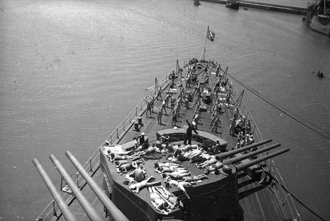 The sailors sunbathe on the deck of the Molotov cruiser. Sevastopol. 1944