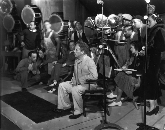 Charles Chaplin and his team on the set of Modern Times (1936).