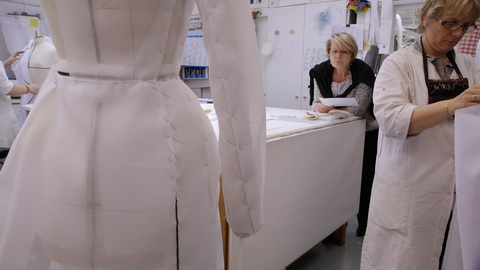 Head seamstresses Monique Bailly reviews a haute couture coat. Credit: CIM Productions