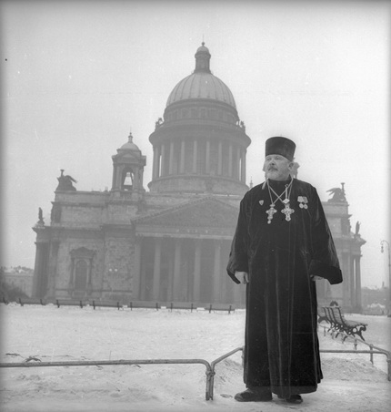 Priest Lomakin on the background of St. Isaac's Cathedral. Leningrad. 1945