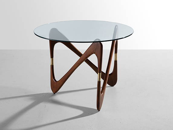 Coffee table with a figured base, 1950's (attributed to Cesare Lakka). Ebony wood, polished brass, clear glass. Courtesy of the Palisander Gallery