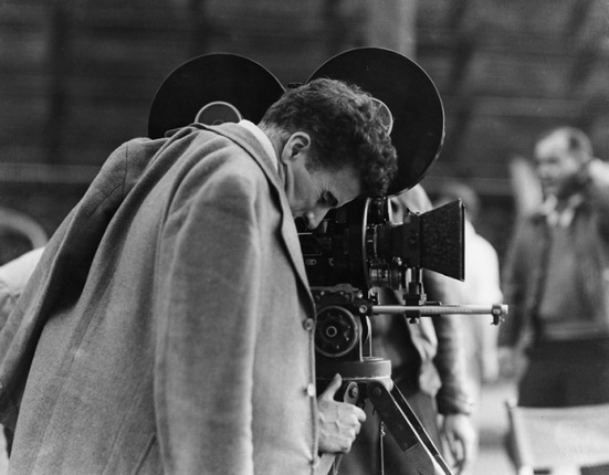 Charles Chaplin, on the set of Modern Times (1936).